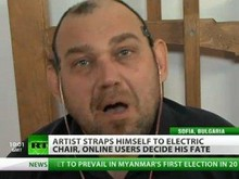 Олег Мавроматти на электрическом стуле. Кадр телеканала Russia Today
